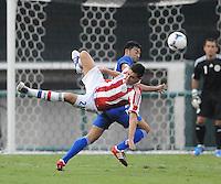 Guatemala forward Carlos Ruiz (20) goes against Paraguay defender Antolin Alcaraz (21)   Guatemala tied Paraguay 3-3 in a international friendly match at RFK Stadium, Wednesday August 15, 2012.