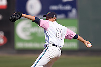 August 30, 2009: Everett AquaSox pitcher Bradley Reid toes the rubber against the Salem-Keizer Volcanes during a Northwest League game at Everett Memorial Stadium in Everett, Washington.   The AquaSox wore pink jersey for breast cancer awareness..