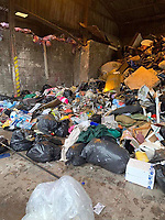 """Pictured: The pile of rubbish that had to be searched for the lost engagement ring.<br /> Re: A woman who accidentally threw away her engagement ring has thanked recycling centre staff for finding it among piles of rubbish in Monmouthshire, Wales, UK.<br /> Two workers at Five Lanes recycling centre in Caldicot, """"trawled through hundreds of bags"""" to find it.<br /> Jo Carter realised on Saturday she had lost it and it had been taken to the tip along with 15 other black bags.<br /> Two Monmouthshire council workers spent four hours trying to find it.<br /> Mr and Mrs Carter got engaged 15 years ago, but she did not put on the £3000 ring very often."""