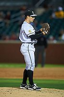Jacksonville Suns pitcher Matt Tomshaw (18) gets ready to deliver a pitch during a game game against the Chattanooga Lookouts on April 30, 2015 at AT&T Field in Chattanooga, Tennessee.  Jacksonville defeated Chattanooga 6-4.  (Mike Janes/Four Seam Images)