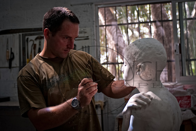 Finishing touches are cleaned up on one of the over four hundred sculptures scheduled to be installed on the sea floor in the waters off Cancun, Mexico. When complete, it will become the world's largest underwater museum as well as an artificial reef.