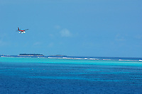 Seaplane about to land on the surface of the sea, Maldives.