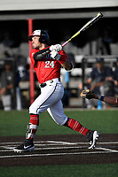 Right fielder Jeffrey Chandler (24) of the North Greenville Crusaders bats a game against the Palm Beach Atlantic Sailfish on Monday, February 25, 2019, at Ashmore Park in Tigerville, South Carolina. Palm Beach won, 7-5. (Tom Priddy/Four Seam Images)