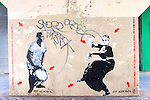 Jef Aerosel stencil artwork on a wall in a Paris alleyway.