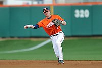Virginia Cavaliers shortstop Brandon Cogswell #7 throws to first during a game against the Clemson Tigers at Doug Kingsmore Stadium on March 15, 2013 in Clemson, South Carolina. The Cavaliers won 6-5.(Tony Farlow/Four Seam Images).