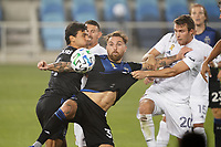 SAN JOSE, CA - SEPTEMBER 13: Guram Kashia #37 of the San Jose Earthquakes plays the ball under pressure from Nick DePuy #20 of the Los Angeles Galaxy during a game between Los Angeles Galaxy and San Jose Earthquakes at Earthquakes Stadium on September 13, 2020 in San Jose, California.