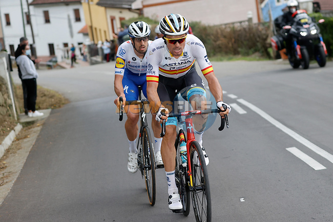 Spanish Champion Luis Leon Sanchez (ESP) Astana and Andrea Bagioli (ITA) Deceuninck-Quick Step attack from the 21 man breakaway group during Stage 12 of the Vuelta Espana 2020 running 109.4km from Pola de Laviana to Alto de l'Angliru, Spain. 1st November 2020.    <br /> Picture: Luis Angel Gomez/PhotoSportGomez | Cyclefile<br /> <br /> All photos usage must carry mandatory copyright credit (© Cyclefile | Luis Angel Gomez/PhotoSportGomez)