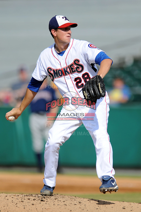 Tennessee Smokies starting pitcher Kyle Hendricks #28 delivers a pitch during game one of a double header against the Huntsville Stars at Smokies Park on July 8, 2013 in Kodak, Tennessee. The Stars won the game 2-0. (Tony Farlow/Four Seam Images)