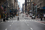 Pedestrians cross Fifth Avenue in New York, U.S., on Thursday, March 19, 2020. New York state Governor Andrew Cuomo on Thursday ordered businesses to keep 75% of their workforce home as the number of coronavirus cases rises rapidly. Photograph by Michael Nagle/Redux