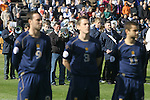 Faroe Islands 0 Scotland 2, 06/06/2007. European Championship Qualifier. Three Scotland players standing to attention as the Faroese band plays the national anthems before the Euro 2008 group B qualifying match at the Svangaskard stadium in Toftir between the Faroe Islands and Scotland. The visitors won the match by 2 goals to nil to stay in contention for a place at the European football championships which were to be held in Switzerland and Austria in the Summer of 2008. It was the first time Scotland had won in the Faroes, the previous two matches ended in draws. Photo by Colin McPherson.