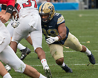 Pitt linebacker Saleem Brightwell (39) makes a tackle. The Pitt Panthers defeated the Youngstown State Penguins 28-21 in overtime at Heinz Field, Pittsburgh, Pennsylvania on September 02, 2017.