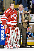 Kieran Millan (BU - 31) poses for the cameras after winning the 2012 Eberly Award for best cumulative Beanpot save percentage. - The Boston College Eagles defeated the Boston University Terriers 3-2 (OT) to win the 2012 Beanpot championship on Monday, February 13, 2012, at TD Garden in Boston, Massachusetts.