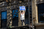 A woman holding a Biden Harris sign celebrates on her fire escape after former Vice President Joe Biden was declared the winner of the 2020 presidential election between U.S. President Donald Trump and Biden on November 7, 2020 in New York City.  Photograph by Michael Nagle