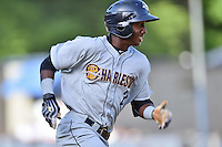 Charleston RiverDogs shortstop Jorge Mateo (2) runs to first during a game against the Asheville Tourists on June 13, 2015 in Asheville, North Carolina. The Tourists defeated the RiverDogs 10-6. (Tony Farlow/Four Seam Images)