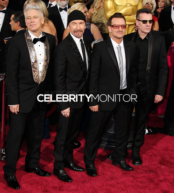 HOLLYWOOD, CA, USA - MARCH 02: Adam Clayton, The Edge, Bono and Larry Mullen Jr of U2 at the 86th Annual Academy Awards held at Dolby Theatre on March 2, 2014 in Hollywood, Los Angeles, California, United States. (Photo by Xavier Collin/Celebrity Monitor)