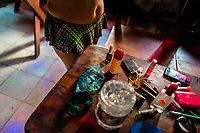 Cosmetics, makeup and beauty products are seen lying on the table before the beginning of the work shift in a sex club in San Salvador, El Salvador, 13 November 2016. Sex workers' task in the club is to be an entertaining and seductive companion. Performing erotic dance on the pole they make the customers stay as long as possible and buy relatively expensive alcoholic beverages from which they have a certain share. Sex workers are not obliged to have sexual intercourse with the club customers, they decide themselves, usually according to their current economic situation.