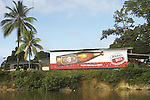 Store with beer advertisement deep in the jungle on the Marowijne River, Suriname.