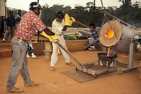 Ivory Coast (Cote d'Ivoire).  Pouring two weeks' gold production, Afema Mine.