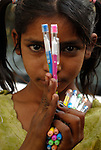 Girl selling pens in the Paharganj district of New Delhi, India.