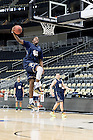 Mar. 20, 2015; Eric Katenda dunks during practice at the Consol Energy Center in Pittsburgh. (Photo by Matt Cashore/University of Notre Dame)