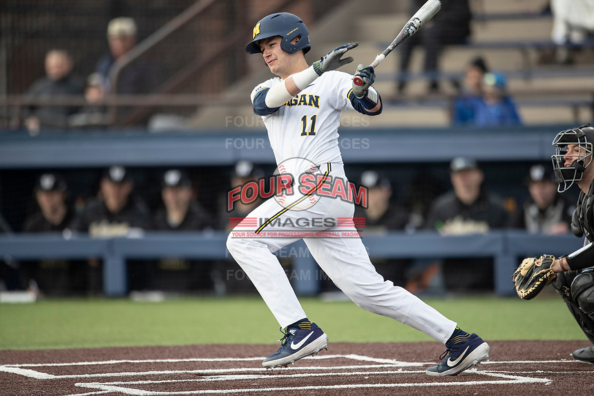 Michigan Wolverines catcher Harrison Slater (11) follows through on his swing against the Western Michigan Broncos on March 18, 2019 in the NCAA baseball game at Ray Fisher Stadium in Ann Arbor, Michigan. Michigan defeated Western Michigan 12-5. (Andrew Woolley/Four Seam Images)