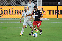 WASHINGTON, DC - AUGUST 25: Edison Flores #10 of D.C. United battles for the ball with Kelyn Rowe #11 of New England Revolution during a game between New England Revolution and D.C. United at Audi Field on August 25, 2020 in Washington, DC.