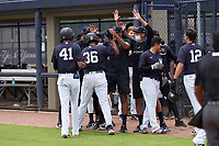 FCL Yankees Jose Martinez (36) high fives teammates after hitting a home run during a game against the FCL Phillies on July 6, 2021 at the Yankees Minor League Complex in Tampa, Florida.  (Mike Janes/Four Seam Images)