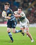 Ceri Sweeney of Cardiff Blues is snagged by the Leinster defence.