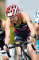 01 SEP 2013 - SARTROUVILLE, FRA - Michelle Flipo, racing for Tri Val de Gray, climbs a hill on the bike during the women's Grand Prix de Triathlon de Sartrouville in Sartrouville, France (PHOTO COPYRIGHT © 2013 NIGEL FARROW, ALL RIGHTS RESERVED)