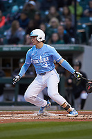 Kyle Datres (3) of the North Carolina Tar Heels follows through on his swing against the Charlotte 49ers at BB&T BallPark on March 27, 2018 in Charlotte, North Carolina. The Tar Heels defeated the 49ers 14-2. (Brian Westerholt/Four Seam Images)