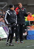Liverpool manager Jurgen Klopp (R) and Swansea head coach Francesco Guidolin (L) during the Barclays Premier League match between Swansea City and Liverpool at the Liberty Stadium, Swansea on Sunday May 1st 2016