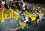 Green Bay Packers receivers Greg Jennings, left, and Jordy Nelson circle the stadium giving high fives following the 10-3 win over the Chicago Bears at Lambeau Field in Green Bay, Wis.,  on Jan. 2, 2011.
