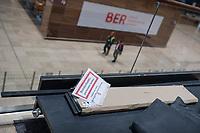 """Die Flughafen Berlin Brandenburg GmbH lud am Montag den 25. November 2019 zu einem Pressebesichtigungstermin auf dem im Bau befindlichen Flughafen BER in Schoenefeld.<br /> Im Bild: Baumaterial mit einem Hinweisschild """"Brandschutztuer geschlossen halten"""" in der Abflughalle.<br /> 25.11.2019, Schoenefeld<br /> Copyright: Christian-Ditsch.de<br /> [Inhaltsveraendernde Manipulation des Fotos nur nach ausdruecklicher Genehmigung des Fotografen. Vereinbarungen ueber Abtretung von Persoenlichkeitsrechten/Model Release der abgebildeten Person/Personen liegen nicht vor. NO MODEL RELEASE! Nur fuer Redaktionelle Zwecke. Don't publish without copyright Christian-Ditsch.de, Veroeffentlichung nur mit Fotografennennung, sowie gegen Honorar, MwSt. und Beleg. Konto: I N G - D i B a, IBAN DE58500105175400192269, BIC INGDDEFFXXX, Kontakt: post@christian-ditsch.de<br /> Bei der Bearbeitung der Dateiinformationen darf die Urheberkennzeichnung in den EXIF- und  IPTC-Daten nicht entfernt werden, diese sind in digitalen Medien nach §95c UrhG rechtlich geschuetzt. Der Urhebervermerk wird gemaess §13 UrhG verlangt.]"""