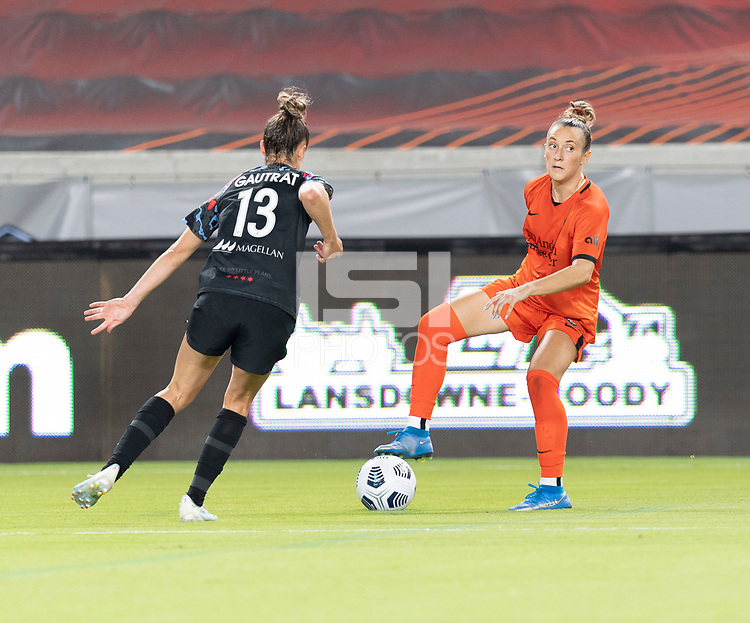 Gabby Seiler #5 of the Houston Dash looks to pass the ball in front of Morgan Gautrat #13 of the Chicago Red Stars during a game between Chicago Red Stars and Houston Dash at BBVA Stadium on September 10, 2021 in Houston, Texas.