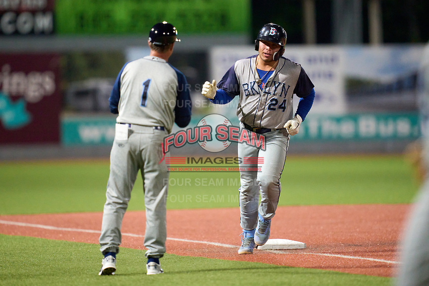 Brooklyn Cyclones manager Ed Blankmeyer (1) shakes hands with Francisco Alvarez (24) as he rounds the bases after hitting a home run during a game against the Hudson Valley Renegades on September 12, 2021 at Dutchess Stadium in Fishkill, New York.  (Mike Janes/Four Seam Images)