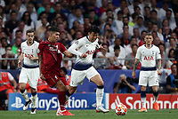 Tottenham Hotspur's Heung-Min Son, right, is chased by Liverpool's Roberto Firmino during the UEFA Champions League final football match between Tottenham Hotspur and Liverpool at Madrid's Wanda Metropolitano Stadium, Spain, June 1, 2019.<br /> UPDATE IMAGES PRESS/Isabella Bonotto