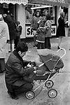 Farther with baby in pram and puppy pet dog. Bridlington Yorkshire, 1972,