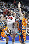 Real Madrid's Sergio Llull (l) and Valencia BC's Sam Van Rossom during Liga Endesa ACB 1st Semifinal match. June 4,2015. (ALTERPHOTOS/Acero)