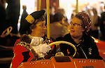 King Lynn annual Mart February 14th fair. Norfolk UK. Town Hall dignitaries take a ride to open the annual mart in a dodgem car. 1982, 1980S UK