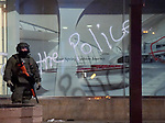 BOSTON MAY 31:  A heavily armed officer at the in front of Copley Place  after looters were inside early Monday morning,  June 1, 2020, in Boston. (Jim Michaud / MediaNews Group/Boston Herald)