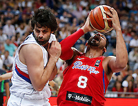 BELGRADE, SERBIA - JULY 04: Angel Vassallo Colon (R) of Puerto Rico is fouled by Milos Teodosic (L) of Serbia during the 2016 FIBA World Olympic Qualifying basketball Group A match between Serbia and Puerto Rico at Kombank Arena on July 04, 2016 in Belgrade, Serbia. (Photo by Srdjan Stevanovic/Getty Images)