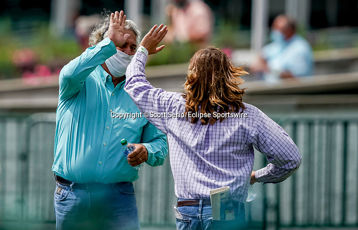 September 1, 2020: Erik Asmussen gets a high-five from his father Trainer Steve Asmussen after their horse Allege won a maiden race on opening day of Kentucky Derby Week at Churchill Downs in Louisville, Kentucky. Scott Serio/Eclipse Sportswire/CSM