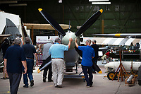 BNPS.co.uk (01202) 558833. <br /> Pic: CorinMesser/BNPS<br /> <br /> Pictured: Volunteers push the Spitfire into the hanger. <br /> <br /> A full-sized model Spitfire has been built as a memorial to the women and children who constructed over 2,000 of them in secret during World War Two.<br /> <br /> The crucial little-known operation involved just a few hundred people who operated in requisitioned car garages, sheds, workshops and factories in the city of Salisbury, Wilts.<br />  <br /> They had to sign of Official Secrets Act and worked with such discretion that the Wiltshire city's inhabitants were oblivious to it.<br /> <br /> They built the legendary aircraft in piecemeal, with the parts coming together to be assembled in one large factory that is now the local rugby club.