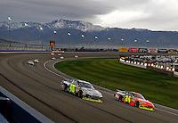Feb 22, 2009; Fontana, CA, USA; NASCAR Sprint Cup Series driver Jimmie Johnson (48) races alongside teammate Jeff Gordon (24) for the lead during the Auto Club 500 at Auto Club Speedway. Mandatory Credit: Mark J. Rebilas-