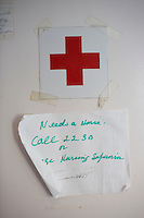 A sign gives contact information for the nurse on duty at the residences in Malone Park at the Fernald Developmental Center in Waltham, Massachusetts, USA.