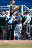 State College Spikes manager Joe Kruzel (13) argues a call with umpires James Jean (left) and Jordan Sandberg (right) during a game against the Batavia Muckdogs on July 8, 2018 at Dwyer Stadium in Batavia, New York.  Batavia defeated State College 8-3.  (Mike Janes/Four Seam Images)