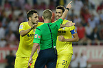 Villarreal players Victor Ruiz (L) and Bruno (R) protesting the penalty that the referee Alejandro J, Henrandez (C) has called during the match between Sevilla FC and Villarreal day 9 spanish  BBVA League 2014-2015 day 5, played at Sanchez Pizjuan stadium in Seville, Spain. (PHOTO: CARLOS BOUZA / BOUZA PRESS / ALTER PHOTOS)