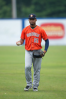 Brauly Mejia (21) of the Greeneville Astros warms up in the outfield prior to the game against the Kingsport Mets at Hunter Wright Stadium on July 7, 2015 in Kingsport, Tennessee.  The Mets defeated the Astros 6-4. (Brian Westerholt/Four Seam Images)