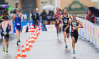 26 AUG 2012 - STOCKHOLM, SWE - Andrea Salvisberg (SUI) of Switzerland (right) during the run at the 2012 ITU Mixed Relay Triathlon World Championships in Gamla Stan, Stockholm, Sweden .(PHOTO (C) 2012 NIGEL FARROW)