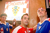 Fans of Croatia cheer on their team during their match against Brazil on June 13, 2006 at the Scorpio Bar in New York City.<br /> <br /> The World Cup, held every four years in different locales, is the world's pre-eminent sports tournament in the world's most popular sport, soccer (or football, as most of the world calls it).  Qualification for the World Cup is open to any country with a national team accredited by FIFA, world soccer's governing body. The first World Cup, organized by FIFA in response to the popularity of the first Olympic Games' soccer tournaments, was held in 1930 in Uruguay and was participated in by 13 nations.    <br /> <br /> As of 2010 there are 208 such teams.  The final field of the World Cup is narrowed down to 32 national teams in the three years preceding the tournament, with each region of the world allotted a specific number of spots.  <br /> <br /> The World Cup is the most widely regularly watched event in the world, with soccer teams being a source of national pride.  In most nations, the whole country is at a standstill when their team is playing in the tournament, everyone's eyes glued to their televisions or their ears to the radio, to see if their team will prevail.  While the United States in general is a conspicuous exception to the grip of World Cup fever there is one city that is a rather large exception to that rule.  In New York City, the most diverse city in a nation of immigrants, the melting pot that is America is on full display as fans of all nations gather in all possible venues to watch their teams and celebrate where they have come from.
